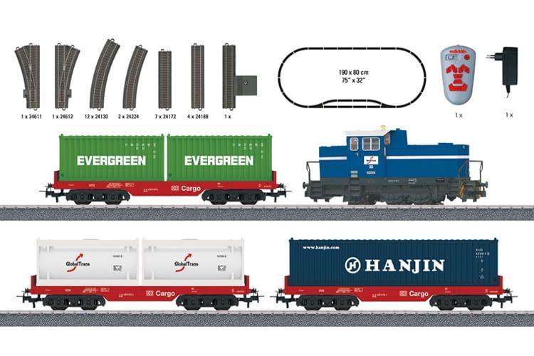 Inhalt des Containerzug Starter-Sets: Lok, Anhänger, Schienen, Controller