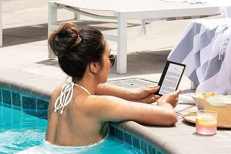 Amazon Kindle Oasis is an e-book reader with a 7 inch display as well as a handle bar and buttons for turning pages